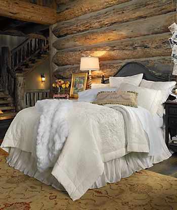log bedroom with white comforter