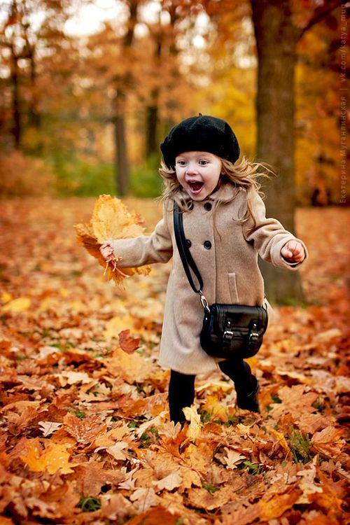 Little girl in autumn leaves