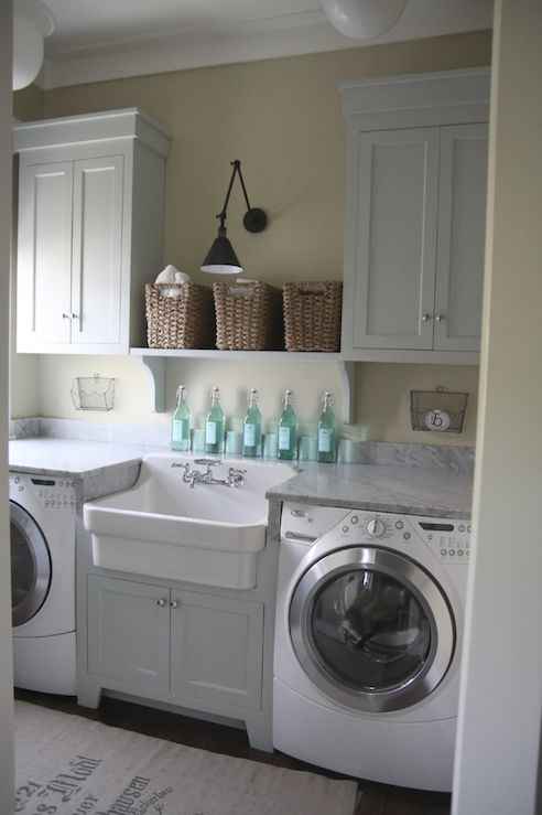 white laundry room with turquoise bottles