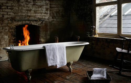 green tub by fireplace