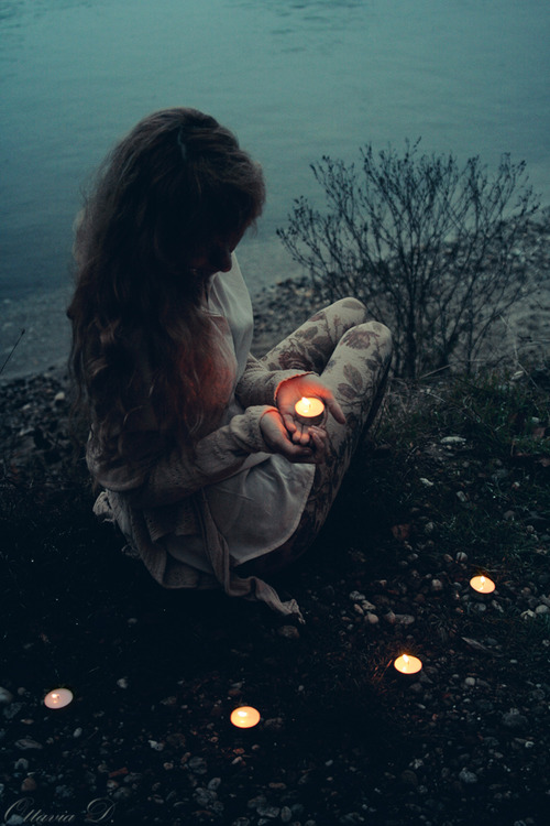 girl with candles in nature
